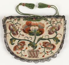 Purse (France), 18th century / White ribbed silk semi-circular purse with drawstring top, embroidered with polychrome silks in floral designs and edged in silver bobbin lace. Lined with blue taffeta; beaded green silk cord at top.
