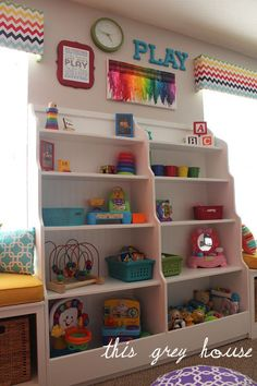 Playroom organization ideas. Also love the crayon canvas art, rolling book shelf and world map wall!