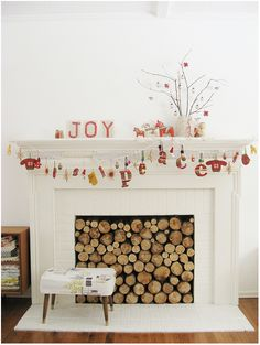 This all white fireplace makes me happy. It so pretty.