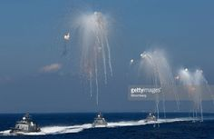 Japan's Maritime Self-Defense Force patrol missile boats launch anti-missile IR decoys during a fleet review at Sagami Bay, off Yokosuka, Kanagawa Prefecture, Japan, on Sunday, Oct. 18, 2015. Prime Minister Shinzo Abe's public approval ratings declined after the passage of legislation allowing Japan to send troops to fight in overseas conflicts for the first time since World War II. Photographer: Tomohiro Ohsumi/Bloomberg via Getty Images