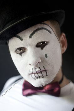 Mime with Mouth Sewn
