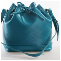 Color: Teal  Material: Genuine Leather  Size: L: 14 inch/36cm, H: 11inch/28 cm, W: 8.5inch/16.5 cm  Inside: Two zipper pockets and two open holders  Top