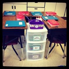 Great desk arrangement. It has supply storage in the middle for kiddos to share!