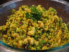 "Moroccan-Inspired Cauliflower ""Couscous"" Salad with cauliflower, dates, raisins, crystallized ginger, cashews, parsley, orange, coconut oil, apple cider vinegar, salt, ground cinnamon, turmeric, ground cumin"