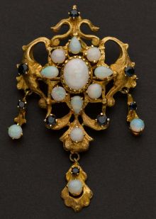 Estate Jewelry:Brooches - Pins, Estate Opal & Gold Pin.  There is a Florenza costume brooch that is very similar in style, a renaissance revival piece.  I wonder if they based their brooch off this design.