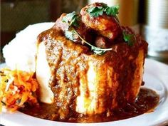"""""""Baby it's cold outside"""" ☃️❄️☃️ Nothing beats a """"Durban Bunny"""" on a day like today! Messy, crude and delicious, a mutton bunny soaked with thick masala gravy, melting potatoes, tender lamb, and vinegar-dressed carrot salad is a taste sensation that will literally explode on your tongue. Carrot Salad, South African Recipes, Gravy, Vinegar, Lamb, Beats, Carrots, Bunny, Potatoes"""