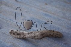 Word in wire. Word in wire. Maguy MamaMaguy DIY wood, leafs, stones and wire Hang. Word in wire. Word in wire. Word in wire. DIY wood, leafs, stones and wire Hang. Word in wire. Driftwood Sculpture, Driftwood Art, Driftwood Wedding, Abstract Sculpture, Bronze Sculpture, Sculpture Art, Wire Crafts, Rock Crafts, Sculptures Sur Fil
