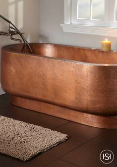 Add elegance to your space with this roomy copper hammered bathtub and pair with a contemporary Signature Hardware faucet. It's a showstopping piece that is perfect for your master bathroom renovation.