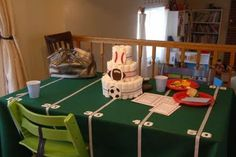 sports theme baby shower   I like the table cloth. Could do with ribbon or tape! Stickers/decals for the #'s