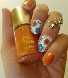 هذه #أظافر اليوم  Orange and Blue Flower Nails using Jiuku (With no name or number)