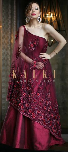 Buy Online from the link below. We ship worldwide (Free Shipping over US$100) Click Anywhere to Tag Plum pink gown in fancy embroidered cape with shoulder drop only on Kalki Plum pink gown featuring in fancy embroidered net with under layer in taffeta silk. Enahcned in fancy sheer cape with shoulder drop. Attached cape is embroidered in cut dan and 3D flower embroidery.