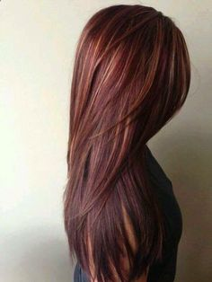 Long hairstyle with Beautiful red/brown mahogany hair colour with caramel blonde highlights peeking out.