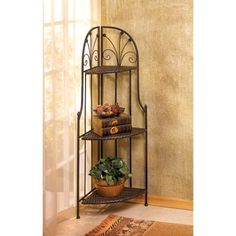 """Our French Market Corner Bakers Rack Shelf will awaken a quiet corner of your bath or home with this rustic storage etagere! Basket-weave textured shelves and slender wrought metal supports add an instant air of Old World elegance to any room. Shelf folds flat for easy storage too! Use in a bathroom to conveniently store towels, bath and body products, cosmetics and small appliances. Measures 13"""" x 13"""" x 46"""" high. Metal with PE rattan. Ships UPS Ground. $89.95"""