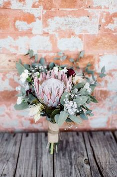 King Protea Blushing Brides make up this inspiring and beautiful bouquet. Inspiration for wedding flowers. Proteas are a great flower to include in your bridal bouquet and centerpieces. Small Wedding Bouquets, Navy Wedding Flowers, Bride Bouquets, Bridal Flowers, Bridesmaid Bouquet, Floral Wedding, Boho Wedding, Wedding Ideas, Protea Bouquet