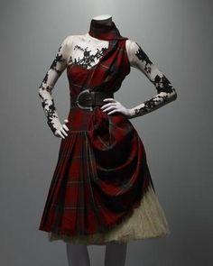 Alexander McQueen (British, 1969–2010). Ensemble, Widows of Culloden, autumn/winter 2006–7. Dress of McQueen wool tartan; top of nude silk net appliquéd with black lace; underskirt of cream silk tulle.