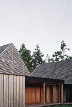 Set at the foot of the Waitakere Ranges is a collection of timber clad, gabled structures. They slip past each other, opening spaces for courtyards, cooking ...