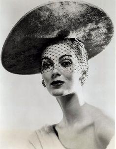 Carmen Dell Orefice wearing a hat by Mr. John | 1953