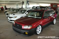I'm really digging this slammed Forester.
