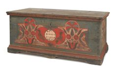 """Pennsylvania painted dower chest, dated 1780, the front with a central red heart with oval inset and two birds flanked by stylized floral trees arising from hearts and two birds, all over four spotted fish, the ends with facing birds and tulips, resting on straight bracket feet, 22"""" h., 46"""" w., 22 1/4"""" d. Illustrated in Schaffner & Klein Folk Hearts, fig. 71 and The Pennsylvania Germans A Celebration of the Arts, fig. 35. Provenance: Collection of Richard and Rosemarie Machmer, Pook & Pook…"""