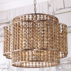 A distinctive scalloped frame encircles a cylindrical metal frame with multiple rows of round aged wood beads. The frames have an aged silver finish. Pair two of these singular chandeliers above a large dining room table or kitchen island. Wood Bead Chandelier, Bathroom Chandelier, Coastal Chandelier, Round Chandelier, Large Chandeliers, Chandelier Shades, Entry Chandelier, Farmhouse Chandelier, Pendant Lights