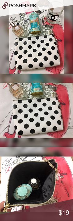 Adorable polka dot cosmetic case! Black and white with gold tone hardware large enough for your day's makeup fits nicely inside a medium size bag Bags Cosmetic Bags & Cases