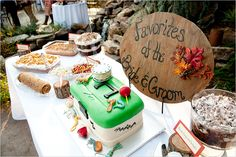 Tackle box groom's cake with a dessert display of some of the family's signature sweets - Photo by Kori