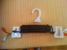 Elektrisch koord op hanger opbergen.