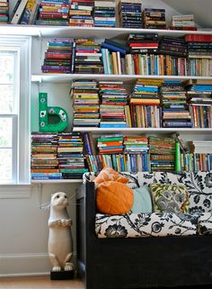 I love the color from all the books.  (lakbdesign - playroom; more colorful images at http://www.lakbdesign.com/lakbdesign/about.html)
