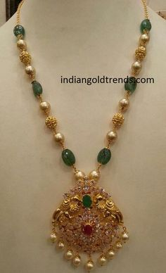 Latest Indian Gold and Diamond Jewellery Designs: emerald Pearl gold beads with peacock pendant #GoldJewelleryLatest