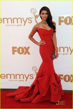 Nina Dobrev is really rocking this long sexy red dress! She looks fabulous!