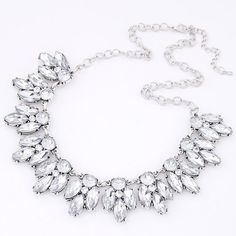 Silver Statement Necklace New without tags. Comes protected in a padded envelope to ensure a safe delivery. All jewelry is buy 2 get 1 free! Necklace has a flaw on the upper right most crystal (it is darker than all the others) please see photo before purchasing. Jewelry Necklaces