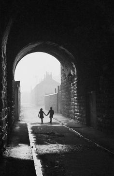 """Bert Hardy, A boy and a girl hold hands under an archway in the """"gorbals"""", a slum district in Glasgow, 1948 http://last-picture-show.tumblr.com/image/76000638567"""