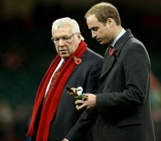 Prince William, Duke of Cambridge carrying gifts for Prince George during an International between Wales and South Africa at Millennium Stadium on November 9, 2013 in Cardiff, Wales