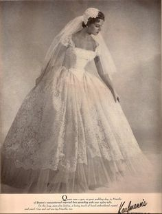 When I was a little girl, this was the kind of gown I daydreamed about--over-the-top lace and organza! Lovely.
