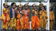 Children in costumes representing Hindu deity Krishna wait to perform ahead of Thursday's Janmashtami Festival in the Indian city of Chandigarh.