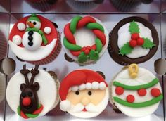 Xmas cupcakes .. Do the one with the green and red rope..