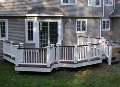 deck with white vinyl rails and kingposts, stadium stairs