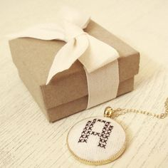 Embroidered custom cross-stitched intial necklace. #typography #crafts