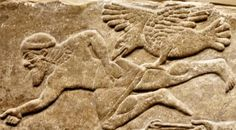 Assyria. A wounded soldier is attacked by a vulture. Relief from Nimrod. (British Museum)