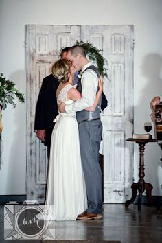 Bride and groom kiss ceremony picture at Elizabeth Claires by Amanda May Photos