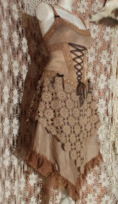 the pirate ghosts wedding dress        tan brown and skin coloured corset openback lacedress in cotton and lace. €200,00, via Etsy.