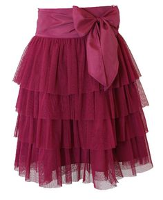 Tutu cute! A favorite of our designer, this layered Purple Gumdrop colored tulle skirt is perfect for any occasion. Wide satin zippered waistband and cute tie help make this a favorite. Also available