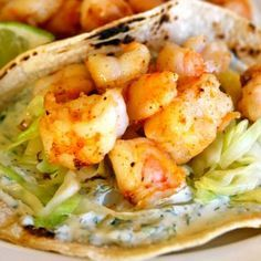 SHRIMP TACOS with CILANTRO LIME SAUCE • Ingredients: 1 lb frozen shrimp – defrosted, deveined, peeled, 6 oz Greek yogurt, ¼ C chopped cilantro, 2 Tb fresh lime juice, ½ tsp cayenne pepper, ½ head of cabbage thinly sliced – about 5 C, 8 corn tortillas, 4 tsp olive oil, Salt & pepper to taste • Yield: 4 servings