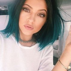 Pretty Makeup.  I hate to say it but she looks much better with lip injections.  Way prettier than before.