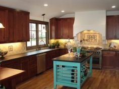 Creamy tiles with lovely stove backsplash and accent tiles true to 1920s California Spanish Revival homes from Stonelite-Tile in San Jose.