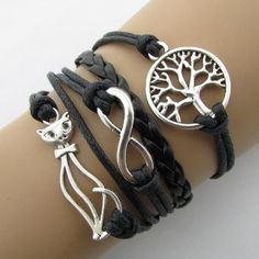 This super cute cat bracelet will make a great gift for a cat lover! The bracelet is adjustable. Leather Cord Bracelets, Braided Bracelets, Layered Bracelets, Leather Jewelry, Handmade Bracelets, Bangle Bracelets, Bangles, Bracelet Men, Leather Chain