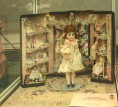 Dollhouse Scale doll's trunk full of tiny dressed dolls in a display by Nancy Richmond. - Photo copyright 2009 Lesley Shepherd.