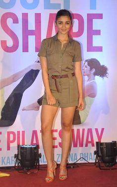 Alia Bhatt was spotted wearing an olive green Karen Millen romper at a recent book launch. The look was understated and chic, styled with nude lips, a sleek ponytail and minimalist ear studs. The only pop of colour came in the form of her orange Steve Madden sandals. Neat! #HauteStepper