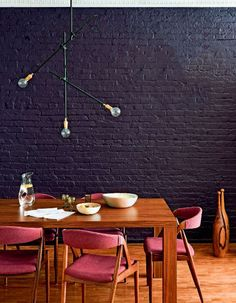 everything about this. the mauve against the wood and black is so good. #diningroom