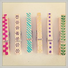 Clothes pins. Organizing all those papers laying around the house or on your fridge. Super easy!